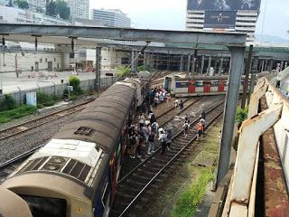 Eight injured after Hong Kong train derails at rush hour