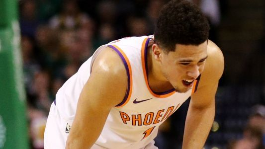 Devin Booker injury update: Suns star carried off court after groin injury