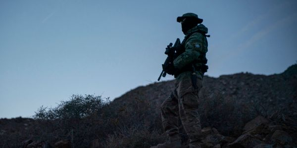 Armed vigilante groups at the US-Mexico border have been stopping migrant families and detaining them at gunpoint
