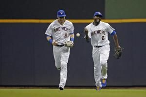McCutchen, Hoskins lead Phillies past Brewers 6-4