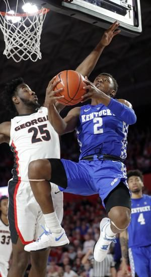 Hagans silences Georgia crowd, lifts No. 12 Kentucky, 69-49
