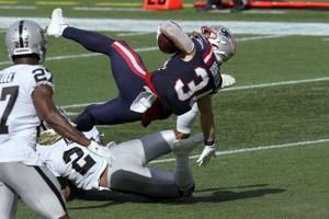 Belichick reaches milestone as Patriots top Raiders 36-20
