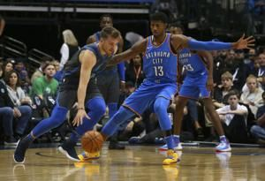 Rookie Doncic, veteran Barea lead Mavs past Thunder 111-96
