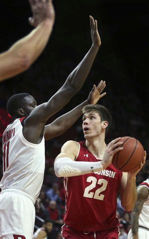 Sanders lifts Rutgers past Wisconsin 64-60