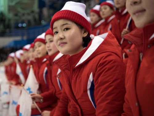 The 229 women in North Korea's 'Army of Beauties' at the Winter Olympics are hand picked, unpaid, and guarded 24/7