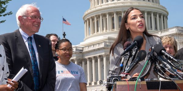 'We need to care for working people as much as we care for the stock market': Alexandria Ocasio-Cortez and Bernie Sanders blasted the Fed's $1.5 trillion injection