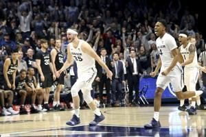 Scruggs leads Xavier's comeback for 70-69 win over Butler
