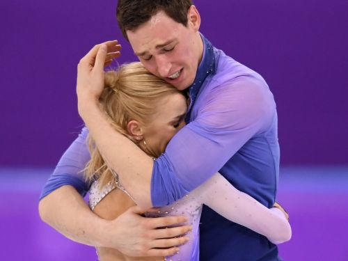Watch 2 figure skaters break down in tears after completing a gold-medal routine that broke a world record