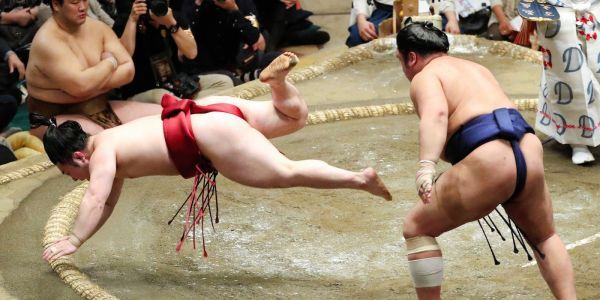 Trump will award a custom 'Trump Cup' to the winner of Japan's sumo wrestling championships, but will break Japanese custom by refusing to sit on the floor