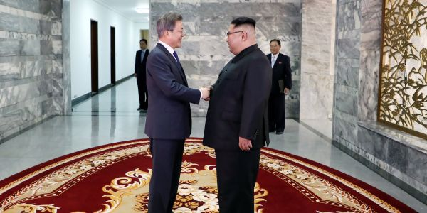 Leaders of North and South Korea hold a surprise meeting before a planned summit between Trump and Kim Jong Un