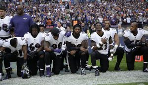 The Latest: More than 200 NFL players don't stand for anthem