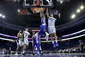 Redick hits 6 3-pointers, 76ers hold off Magic 114-106