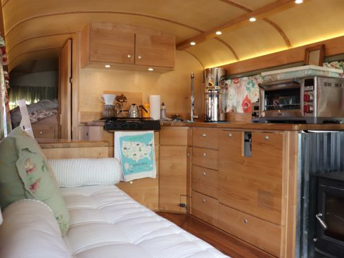 A retiree converted a school bus into a tiny home and now travels the country. Take a look inside in her 'retirement home on wheels.'