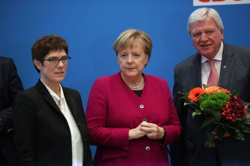 Germany's Angela Merkel prepares to give up party job