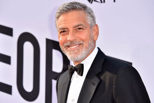 George Clooney says he's been using a Flowbee to cut his hair for years