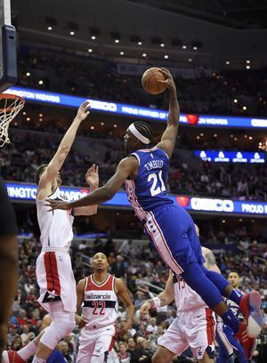 John Wall scores 28 points, Wizards hold on to beat 76ers
