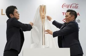 Tokyo Olympics organizers unveil torch for next year's games