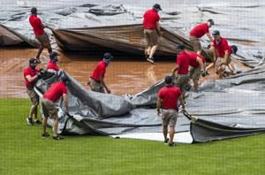 In DC, city of gridlock, tarp stymies Nationals grounds crew