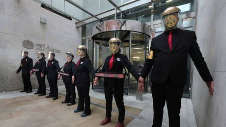 Sticking it to the man: Climate change protesters glue themselves to London Stock Exchange