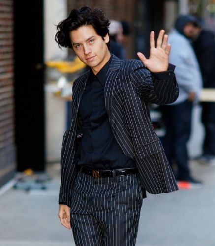 Cole Sprouse Hits the Big Apple in Versace Pinstripe Suit