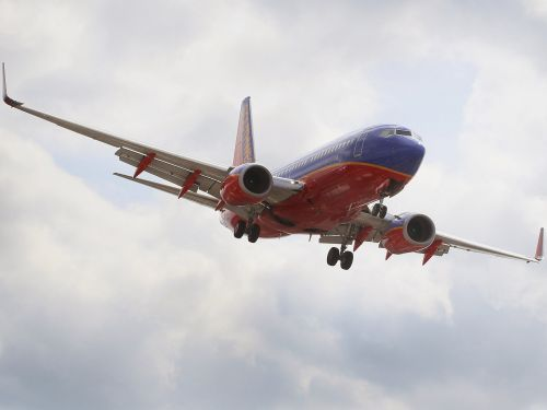 A Southwest passenger forced a plane to land after reportedly smoking marijuana in the bathroom