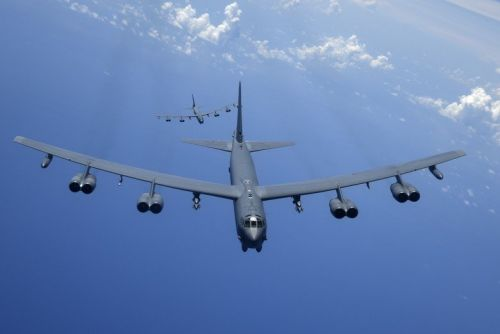 A B-52 bomber shows how it can lay a devastating minefield at sea from nearly 50 miles away in a warning to US rivals