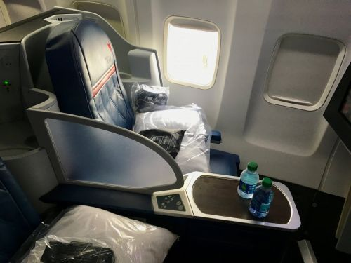 I flew business class on Delta and only paid $5.60 - here's how I did it