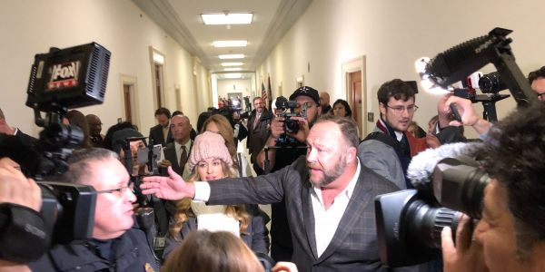 Infowars' Alex Jones slams Google CEO Pichai outside a Congress hearing for its 'evil' China project