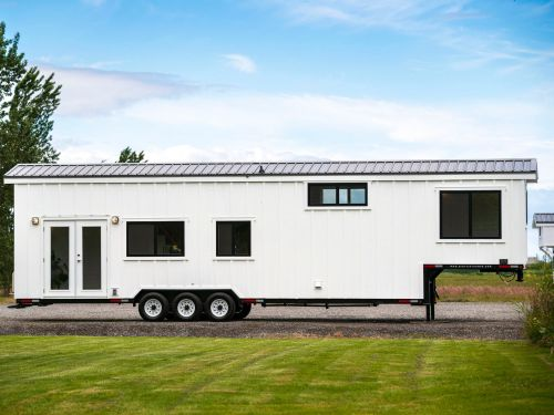 This tiny home on wheels has four rooms and two lofts but can still be towed with a pickup truck - see inside the $111,300 Traveler's Paradise