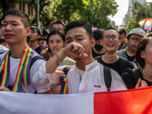 14 inspirational photos of celebrations in Taiwan after it became the first Asian country to legalize same-sex marriage
