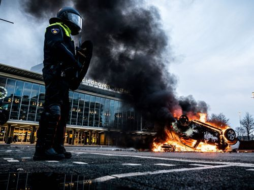 Riots broke out across the Netherlands over its COVID-19 curfew, with people torching a virus testing center and attacking a police station