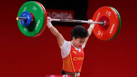 China's Hou Zhihui clinches country's second Olympic GOLD with record-setting weightlifting performance