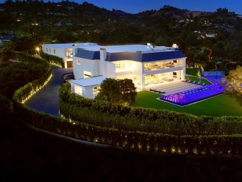 A mountaintop mansion with an indoor basketball court and parking for 80 cars just went on the market in Los Angeles for a whopping $135 million