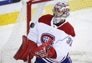 Carey Price makes 43 saves, Canadiens beat Flames 3-2
