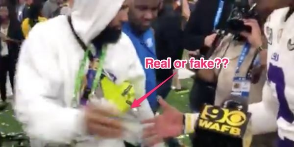 A video appeared to show Odell Beckham Jr giving cash to LSU players after winning the championship, but the school says it was fake money
