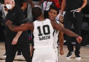 DeRozan scores 27 points to lead Spurs past Kings, 129-120