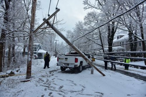 Plow driver trapped by live wires after crash