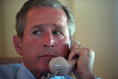 Photos show the moment President George W. Bush learned of the 9/11 attacks