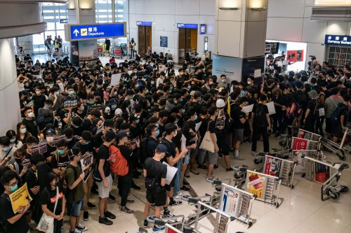 Anti-government protesters severely disrupt Hong Kong International Airport for second day running
