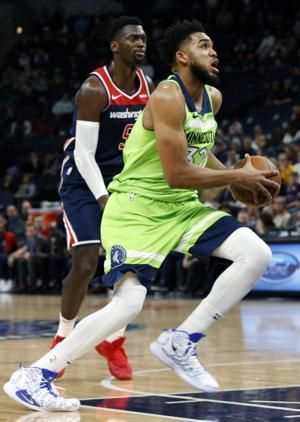 Towns scores 40, leaves Wolves' win with injury