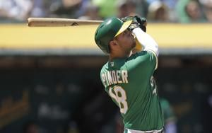 Bailey wins in Oakland debut, Athletics beat Mariners 10-2