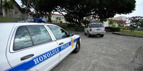 2 Honolulu police officers were killed in a shooting as a nearby house burned