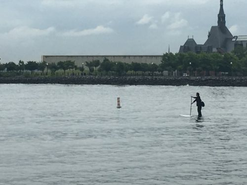 A man was running late for a business meeting in New York City, so naturally he decided to paddle board across the Hudson River in a suit