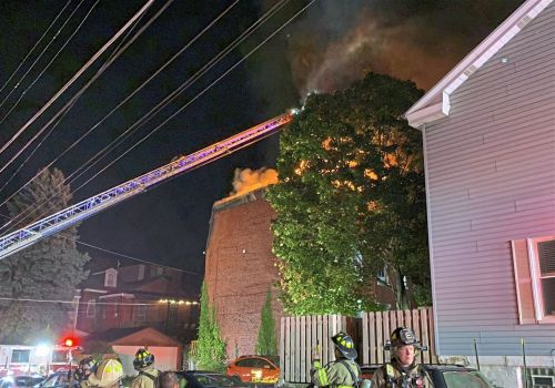 Firefighters respond to third-alarm fire in Lawrenceville