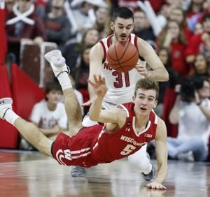 Hellems, NC State pull away to beat Wisconsin, 69-54