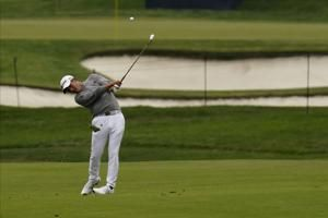 Morikawa delivers great shot in quiet moment to win PGA