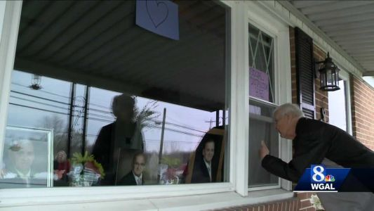 Family says goodbye through a window to relative dying from cancer