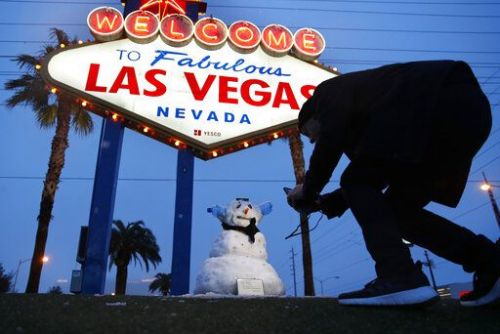 Winter in Las Vegas? Rare weather brings snow angels, snowball fights