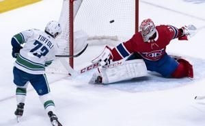 Toffoli scores in overtime, Canucks beat Canadiens 4-3