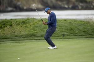 The Latest: Woods gets early work on his putting at US Open